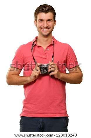 Portrait of a man holding camera on white background