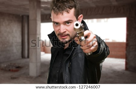 Portrait Of A Man Holding Gun, indoor