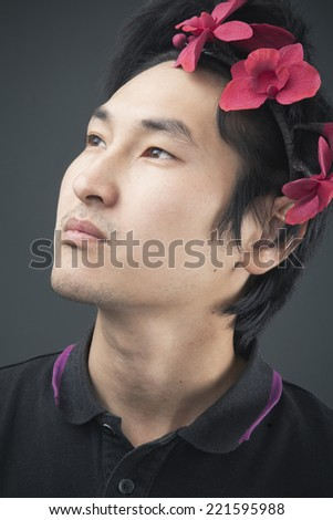 Portrait of a Man in a flower headband - stock photo