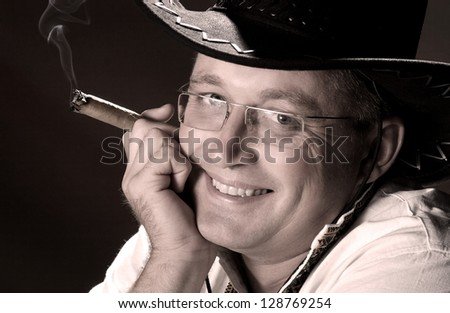 portrait of a man in a hat and with cigar
