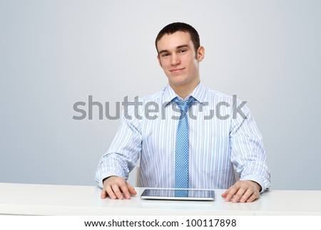Portrait of a man in business wear making presentation - stock photo