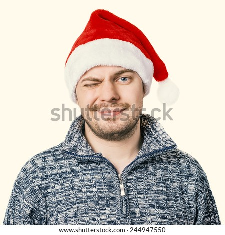 Portrait of a man in sweater with red Santa hat. Color toned. Isolated.