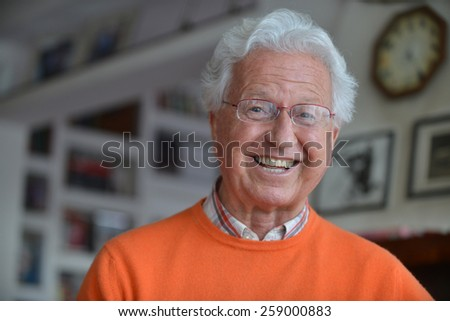 Portrait of a man laughing in his house