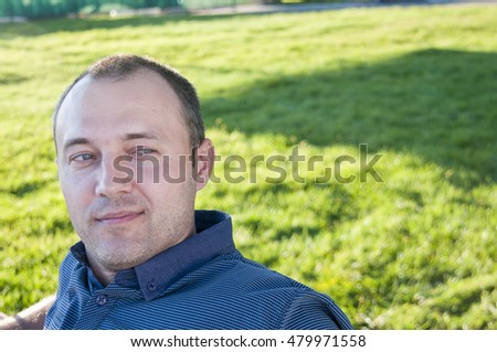 Portrait of a man looking towards the