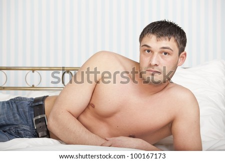 portrait of a man lying on the bed