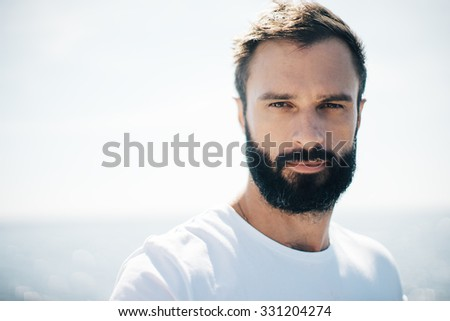 Portrait of a man on the blure sea background