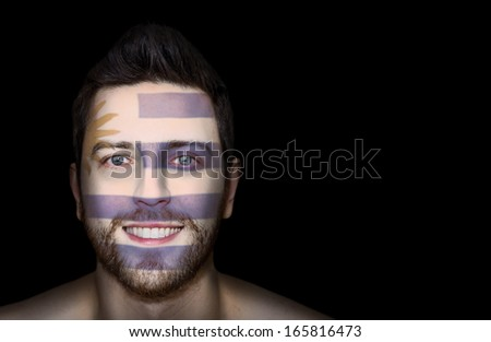 Portrait of a man painted the Flag of Uruguay on his face