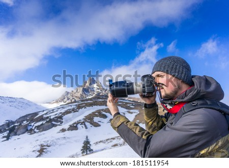 Portrait of a man photographing outdoors - stock photo