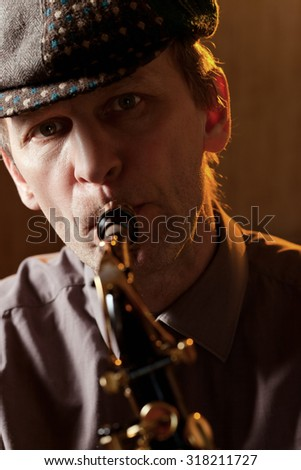 Portrait of a man playing the saxophone