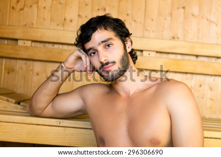 Portrait of a man relaxing in a sauna - stock photo