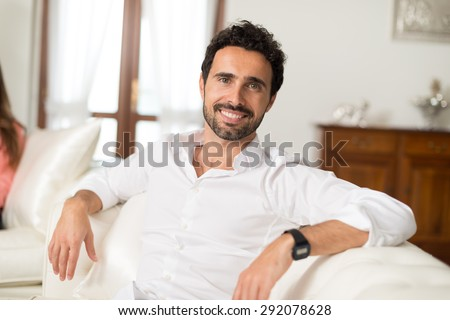 Portrait of a man relaxing in his apartment - stock photo