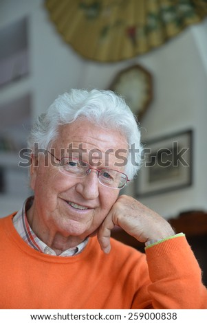 Portrait of a man relaxing in his house - stock photo