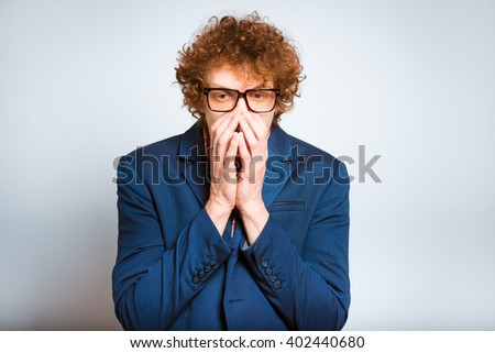portrait of a man scared, isolated on background - stock photo