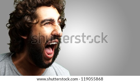 Portrait Of A Man Shouting On Grey Background