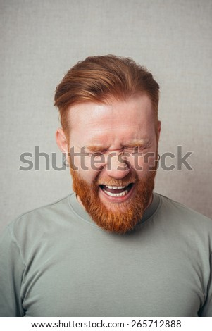 Portrait Of A Man Shouting On Grey Background - stock photo