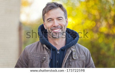 Portrait Of A Man Smiling At The Camera  - stock photo