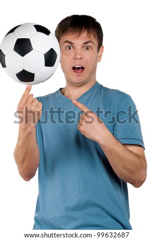 Portrait of a man standing with classic soccer ball on isolated white background