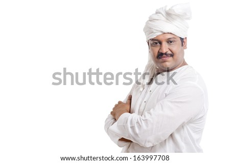 Portrait of a man standing with his arms crossed - stock photo