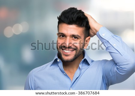 Portrait of a man touching his hair - stock photo