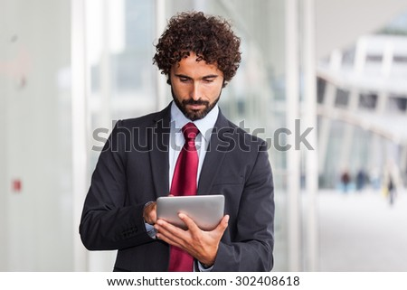 Portrait of a man using a digital tablet - stock photo