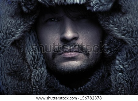 Portrait of a man wearing hood
