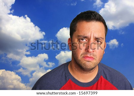 Portrait of a man whose expression reflects being upset - stock photo