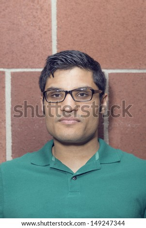 Portrait of a man with a angry face - stock photo
