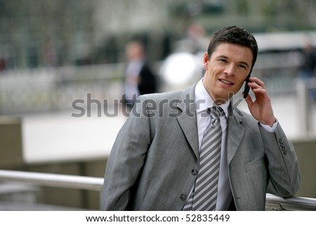 Portrait of a man with a cell phone - stock photo