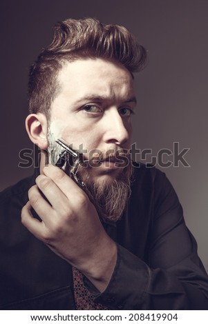 Portrait of a man with a long beard