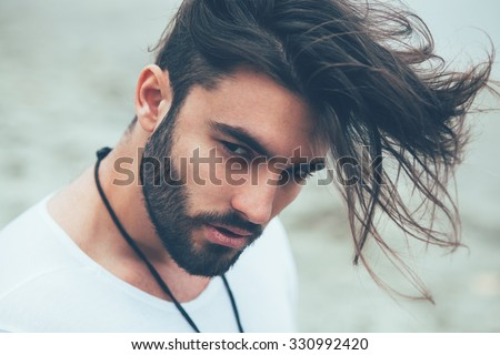 Portrait of a man with beard and modern hairstyle - stock photo