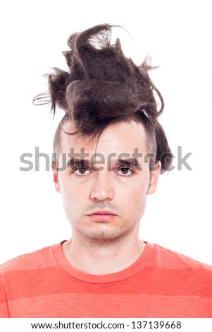 Portrait of a man with crazy haircut, isolated on white background