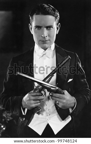 Portrait of a man with dueling pistols - stock photo