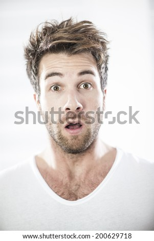 portrait of a man with expressive face - stock photo