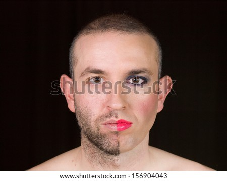 Portrait of a man with half face makeup as a woman and isolated on black background.