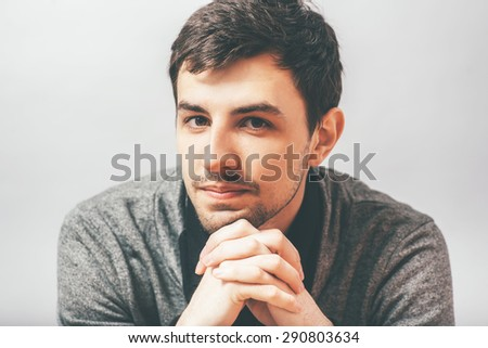 portrait of a man with his chin hands - stock photo
