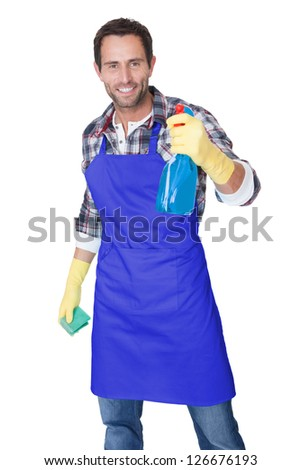 Portrait of a man with sponge and spray ready to clean windows. Isolated on white