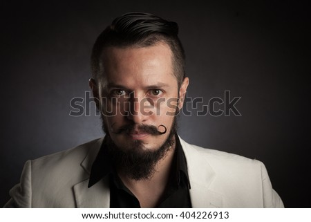 Portrait of a man with stylish bead