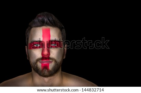 Portrait of a man with the flag of the England painted on his face - stock photo
