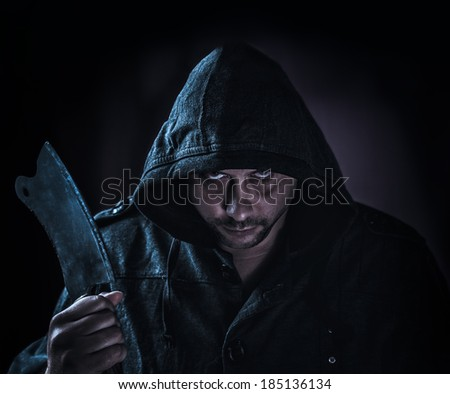 portrait of a maniac killer with a hatchet - stock photo