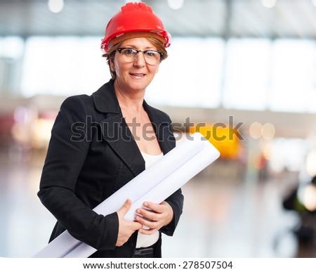 portrait of a mature architect woman holding a plane - stock photo