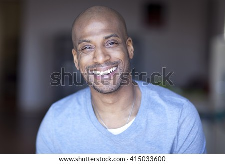Portrait Of A Mature Black Man Smiling At Home - stock photo