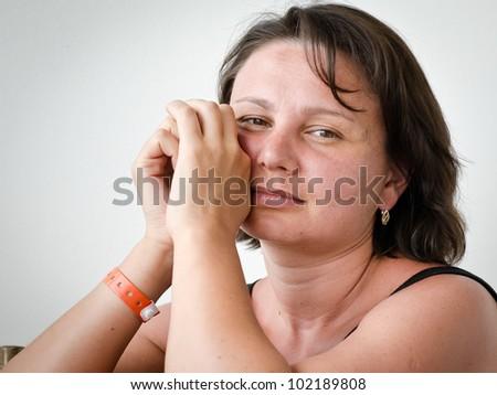 Portrait of a mature brunette - stock photo