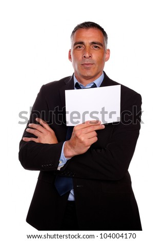 Portrait of a mature business man holding a white card with copyspace on isolated background - stock photo