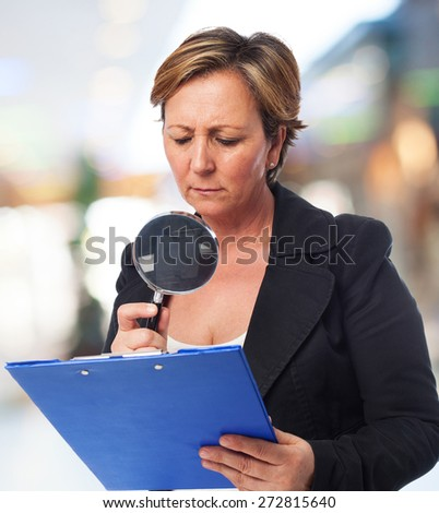 portrait of a mature business woman looking a contract - stock photo