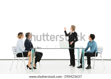 Portrait Of A Mature Businesswoman Giving Presentation