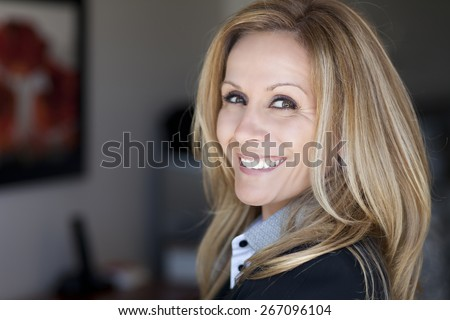 Portrait Of A Mature Businesswoman Working At Home - stock photo