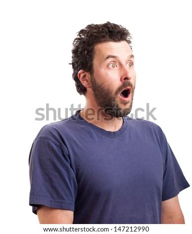 Portrait of a mature Caucasian man with beard and blue shirt, surprised look sideways. - stock photo