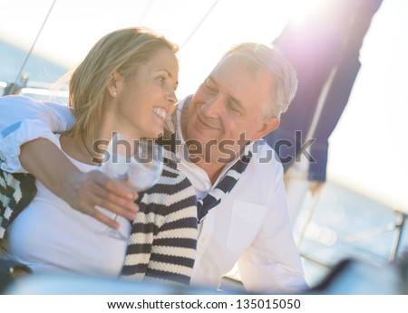 Portrait Of A Mature Couple Drinking A Glass Of Wine Together - stock photo