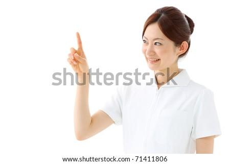 Portrait of a mature female nurse - stock photo