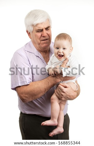 Portrait of a mature grandfather holding grandson over white  - stock photo